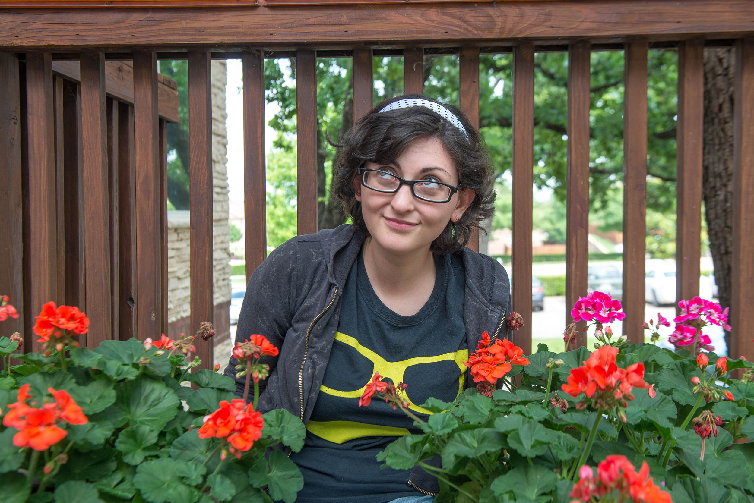 woman sitting in flower bed smiling